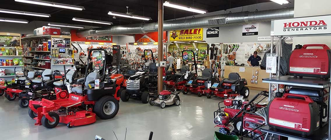 Lawn mowers and tools in hardware store